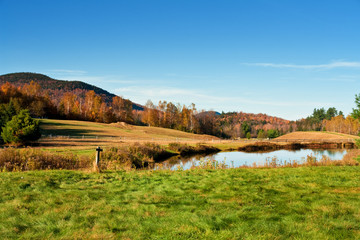 A pond in the country in Autumn in New England