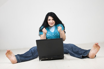 Stressed  woman using laptop
