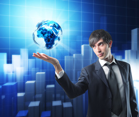 businessman has earth in his hand