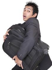 Stressed businessman running w luggage