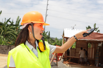 Chinese construction engineer directing