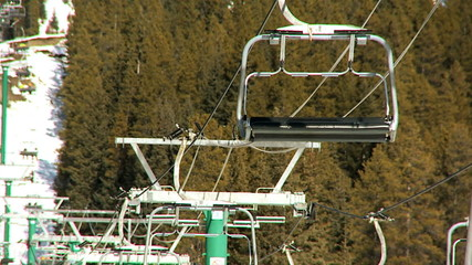 Ski lifts transporting people up the mountain