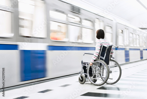Woman in the wheelchair at the underground station