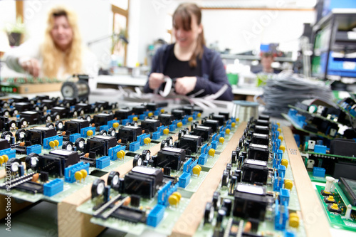 women populating electronic assemblies