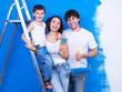 Smiling family with paintbrush