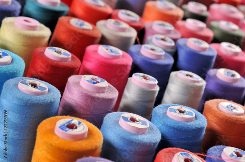 Colorful reels of threads background TAILOR related images.