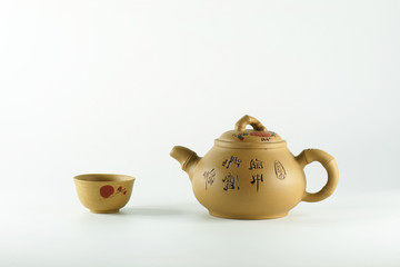 Cup of tea and teapots.