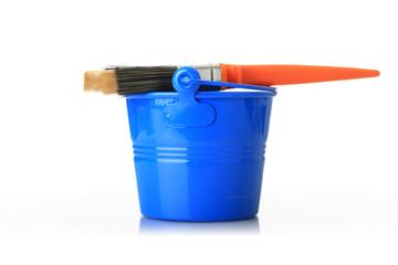 Brush and blue bucket.