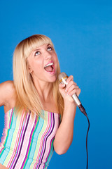 Sweet blonde sings into a microphone