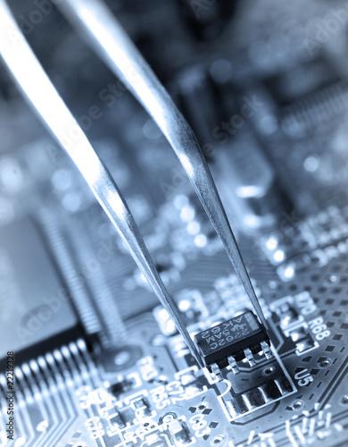 Assembling a circuit board. - 22219328
