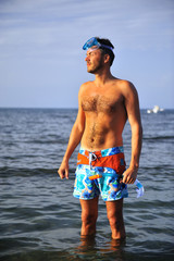 Young happy handsome summer diving man with swimming mask