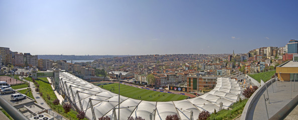 Panoramic cityscape with a sports stadium