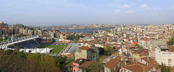 Panoramic cityscape over a residential area with sports stadium