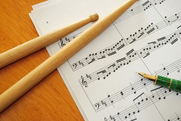 Music score and pen
