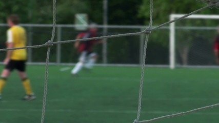 Soccer practice through net soft focus - HD