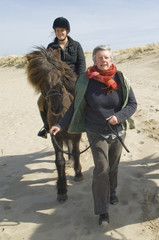 equestrian on horseback on the beach