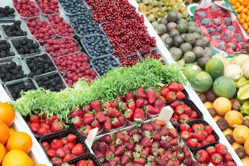 Various berries on market stall
