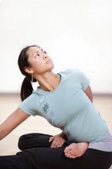 Asian woman in yoga pose.