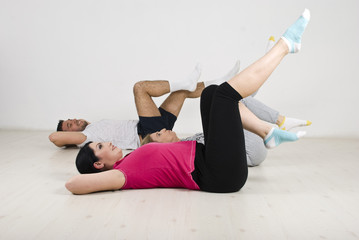 People group doing exercises for legs