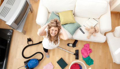 Frustrated blond woman vacuuming the living-room