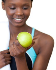 Close-up of a fitness woman eating an apple
