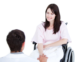 Smiling female patient in a wheelchair interacting with her doct