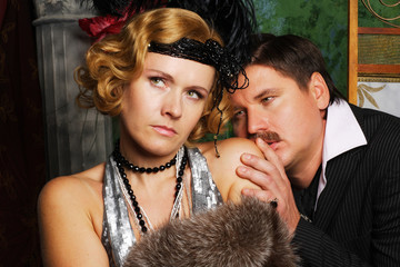 desperate man with mustache and stylish woman