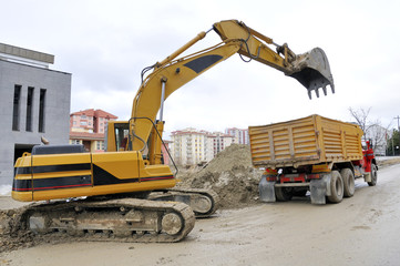Excavator loading a truck - a series of CONSTRUCTION images