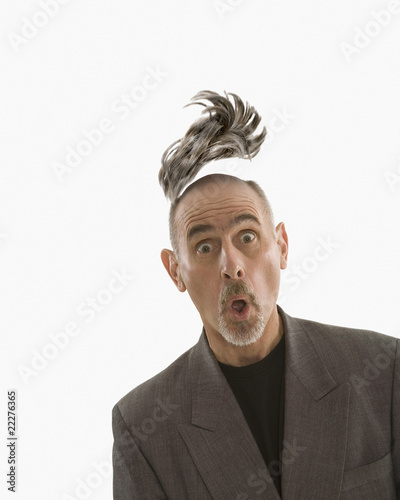 Studio shot of man with toupee floating above head