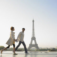 Couple walking with Eiffel Tower in background