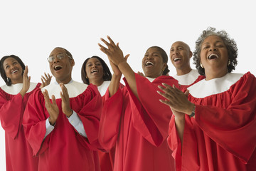 African men and women singing in choir gowns