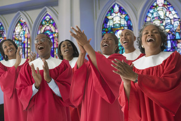 African men and women singing in church choir
