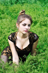 awesome girl sitting in the high grass