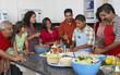 Multi-generational Hispanic family preparing food