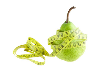 Ripe green pear with measuring tape