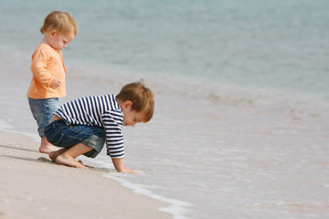 two kids on beach