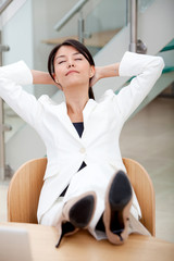 business woman sitting on desk