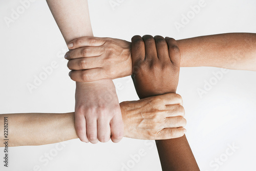 Multi-ethnic women holding wrists