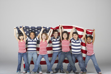 Multi-ethnic children holding American flag
