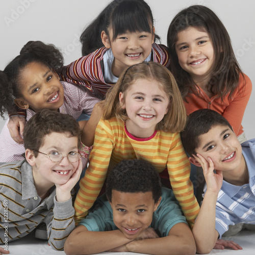 Multi-ethnic children in a pile