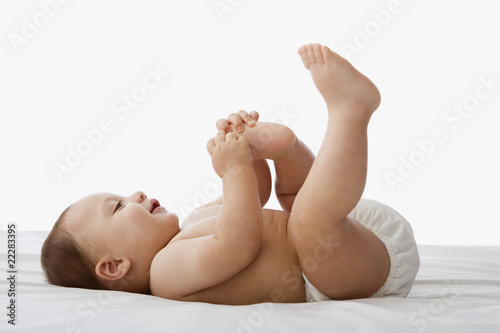 Russian baby playing with toes