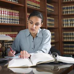 Hispanic female lawyer working in office