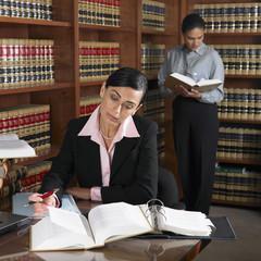 Hispanic female lawyers working in office