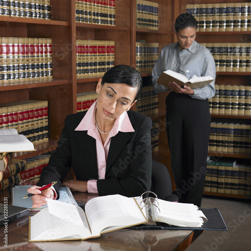 Hispanic female lawyers working in office