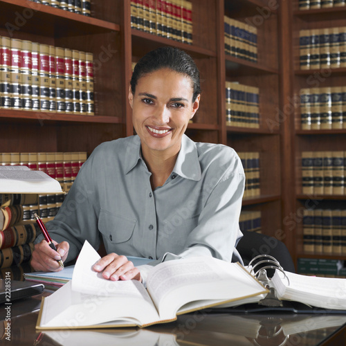 Hispanic female lawyer working in office