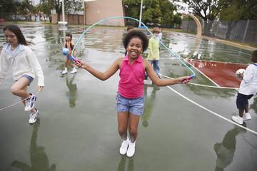 Multi-ethnic children playing in urban area