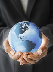 African American businesswoman holding globe