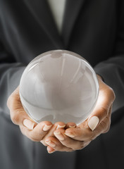 African American businesswoman holding crystal ball