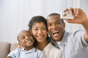 African American family taking own photograph