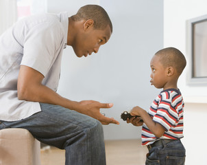 African American father talking to son